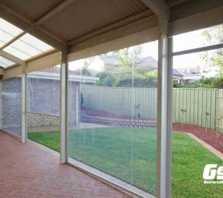 Olympic Retractable Screens Work on Covered Porches & Lanais with Independent Controls