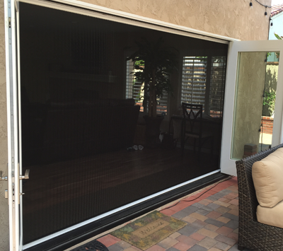 zigzag retractable screen door on bifold opening open from both sides